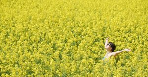 A woman standing in the flower field.