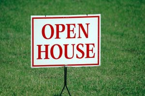 A sign for an open house you'll need to search for when you plan a coast-to-coast move