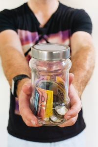 deduct moving expenses - saved money in a jar