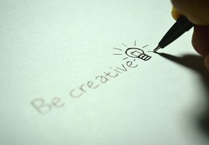 "Written ""be creative"" on a piece of paper"