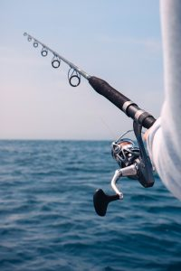 pack fishing equipment - A fishing rod on a boat