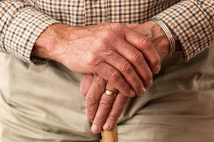 the hands of a senior who is in search of senior moving tips