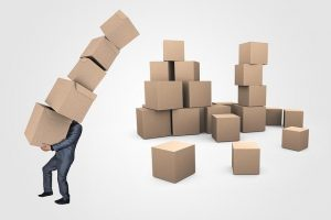 Businessman with moving boxes