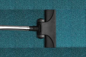 a carpet and a vacuum