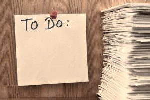 To do list next to a pile of documents