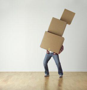 a man balancing boxes