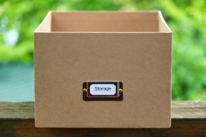 Keeping your storage clean and organized by storing items in moving boxes